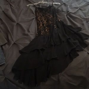 Black asymmetrical dress with gold sequins